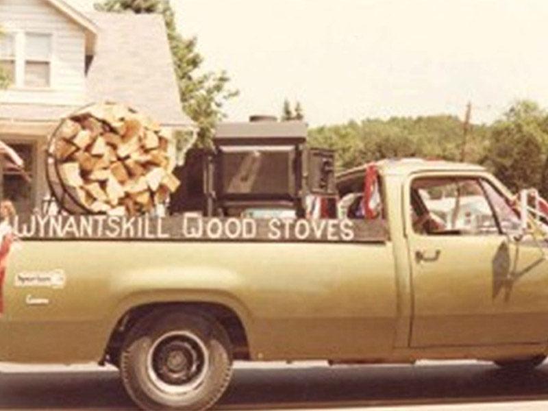Pickup truck hauling wood